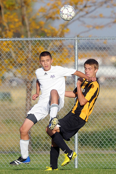 Mountain View High School's Matthew Trevizo, left, and Thompson Valley's Tanner Wall compete for control of the ball in the second half of their match on Wednesday, Oct. 3, 2012 at MVHS.