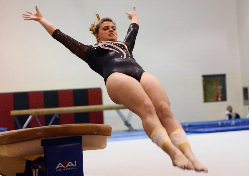 Thompson Valley High School's Emma Applemann performs a vault during a dual meet against Loveland on Tuesday, Oct. 2, 2012 at LHS.