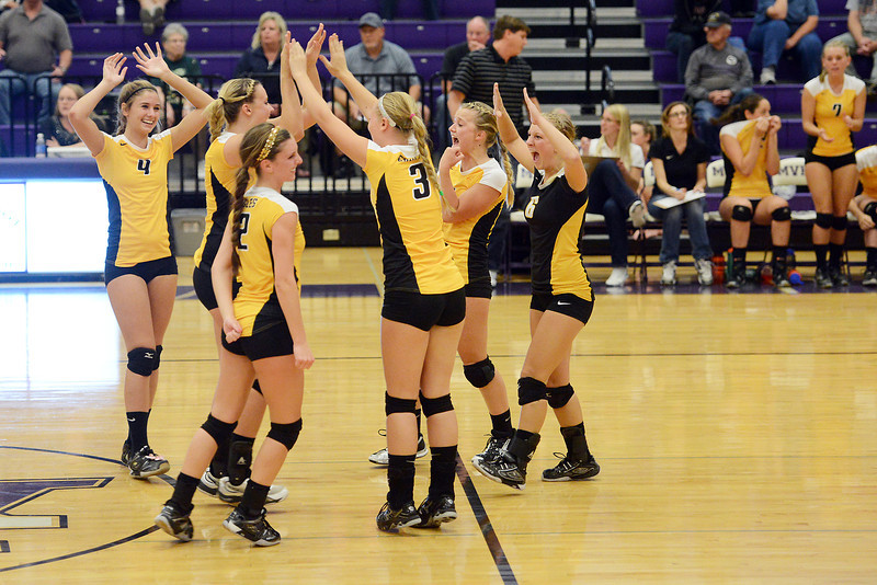 Thompson Valley High School volleyball teammates celebrate after winning set two of their match against  Mountain View on Thursday, Sept. 27, 2012 at MVHS. The Eagles defeated the Mountain Lions, 3-0.