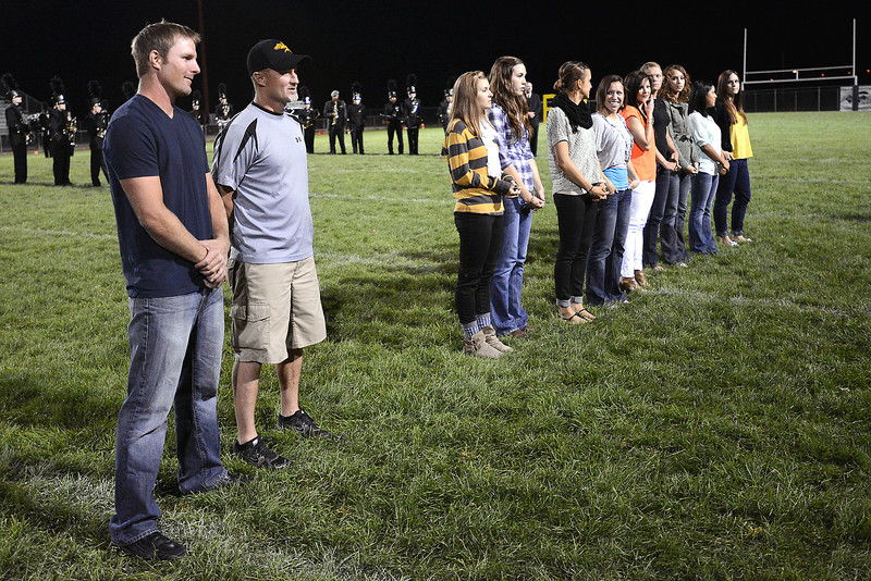 Steve Gerrard, left, and Kevin Johnson stand with other former Thompson Valley High School athletes during a ceremony honoring them at halftime of Thompson Valley's football game against Fort Morgan on Friday, Sept. 14, 2012 at Patterson Stadium.
