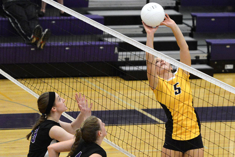 Thompson Valley High School's Hannah McCrimmon, right, goes up against Mountain View's Katie Hanson, left, and Audrey Benedict during set one of their match Thursday, Sept. 27, 2012 at MVHS.