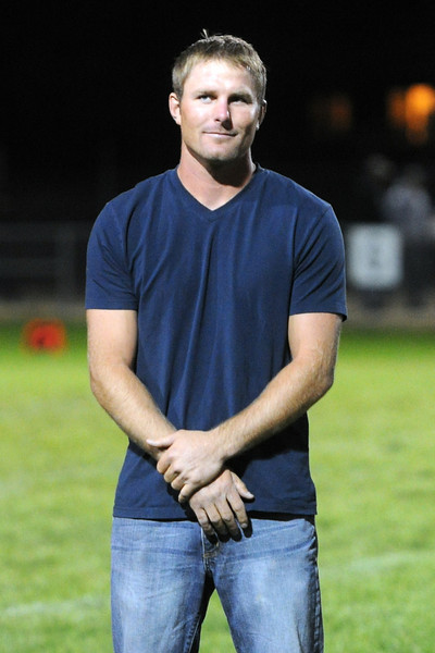 Steve Gerrard listens to a speaker during a ceremony honoring former athletes at halftime of Thompson Valley High School's football game against Fort Morgan on Friday, Sept. 14, 2012 at Patterson Stadium.
