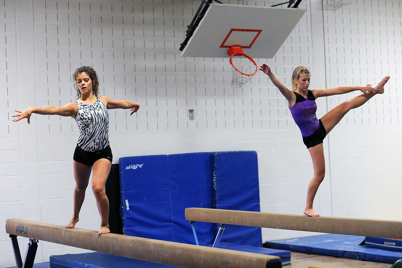 Thompson Valley High School gymnasts Katherine Bosnich, left, and Gretchen Schneider perfect their balance beam skills during practice Friday, Aug. 31, 2012 at TVHS.