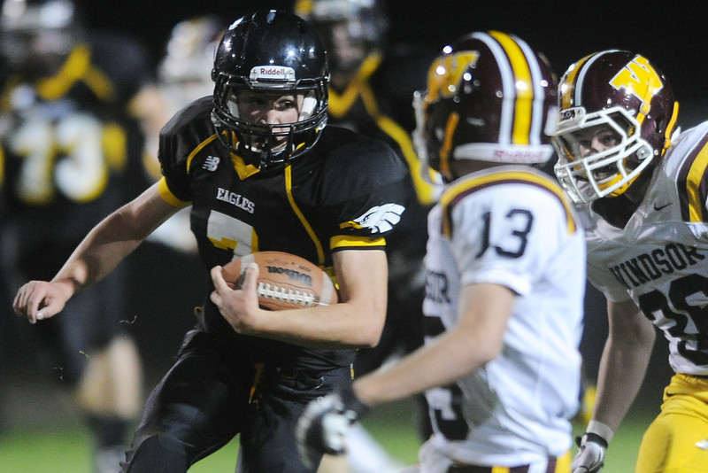 Thompson Valley High School's Josh Strobel, left, returns a kick in the second quarter of a game against Windsor on Thursday, Sept. 20, 2012 at Patterson Stadium.
