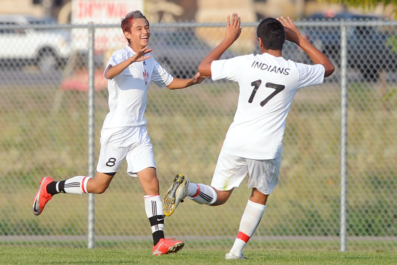 Loveland High School's Adrian Cordova, left, is congratulated by teammate Marco Gonzalez after scoring a goal in the first half of a match against Thompson Valley on Friday, Sept. 21, 2012 at the Mountain View soccer field.