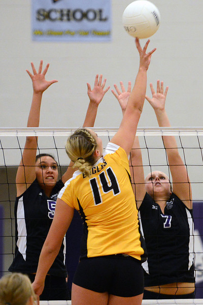 Mountain View High School's Ashley Carrera, left, and Nicole Goddard go up to block Thompson Valley's Taylor Moran during set one of their match Thursday, Sept. 27, 2012 at MVHS.