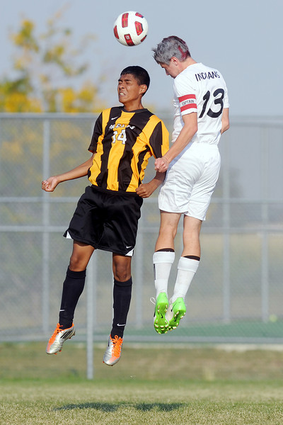 Loveland High School's Joe Etling, right, and Thompson Valley's Francisco Rivera go up for the ball in the first half of their match on Friday, Sept. 21, 2012 at the Mountain View soccer field.