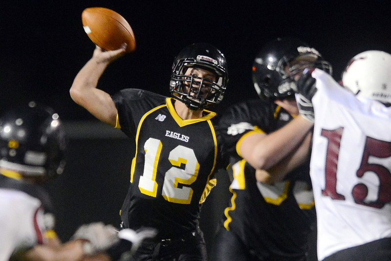 Thompson Valley High School quarterback Spencer Shook throws a pass in the second quarter of a game against Fort Morgan on Friday, Sept. 14, 2012 at Patterson Stadium.