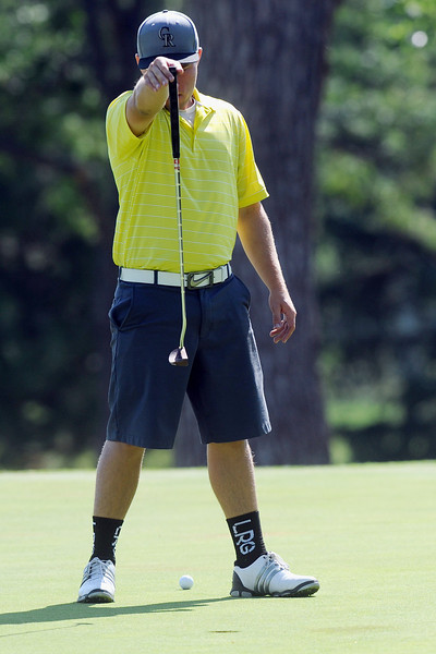 Thompson Valley High School senior Josh McLaughlin lines up his putt  on No. 15 during the Walt Clark Invitational on Sept. 5, 2012 at The Olde Course at Loveland.