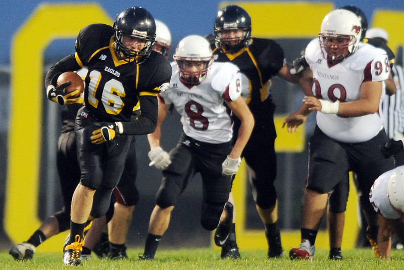Thompson Valley High School's Blake Firchau (16) is pursued by Fort Morgan defender Richard Herrera (8) and Jose Zavala (98) in the first quarter of their game on Friday, Sept. 14, 2012 at Patterson Stadium.