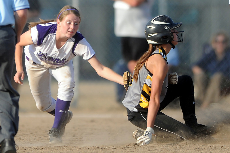 Thompson Valley High School's Hannah Thollot, right, slides safely into second base for a steal ahead of the tag attempt by Mountian View shortstop Gianna Melargno during their game Tuesday, Sept. 18, 2012 at MVHS.