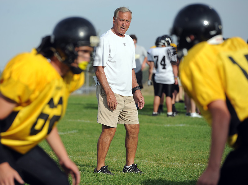 Thompson Valley High School assistant football coach Steve Szabo keeps a close eye on players during practice Monday, September 10, 2012.