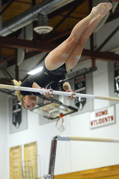 Thompson Valley High School's Erin Chavet perfroms her routine on the uneven bars during the Indians Invitational on Friday, Sept. 7, 2012 at Loveland High School.