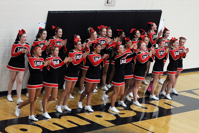 Loveland High School cheerleaders yell encouragement during a volleyball match against Thompson Valley on Friday, Aug. 31, 2012 at TVHS.