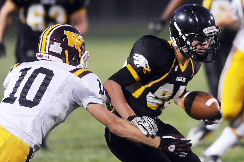 Thompson Valley High School wide receiver Darryn Highland, right, is pursued by Windsor defender Drew Bunday during their game on Thursday, Sept. 20, 2012 at Patterson Stadium.