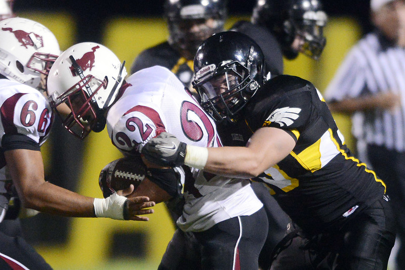 Thompson Valley High School defensive lineman Brian Herr, right, wraps up Fort Morgan running back Cody Davis (22) in the second quarter of their game on Friday, Sept. 14, 2012 at Patterson Stadium.