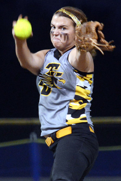 Thompson Valley High School's Kinsley Mason winds up before throwing a pitch in the bottom of the third inning of a game against Loveland on Friday, Sept. 21, 2012 at Centennial Park.