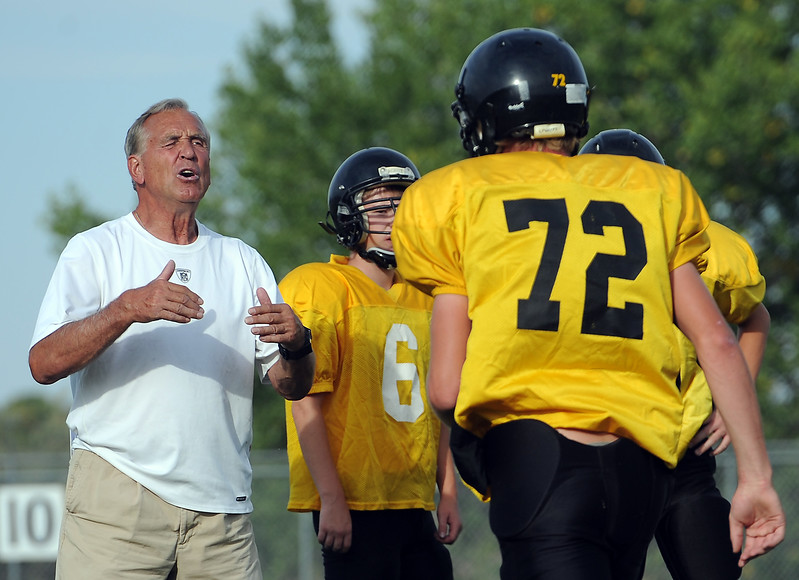 Thompson Valley High School assistant football coach Steve Szabo directs players during practice Monday, September 10, 2012.