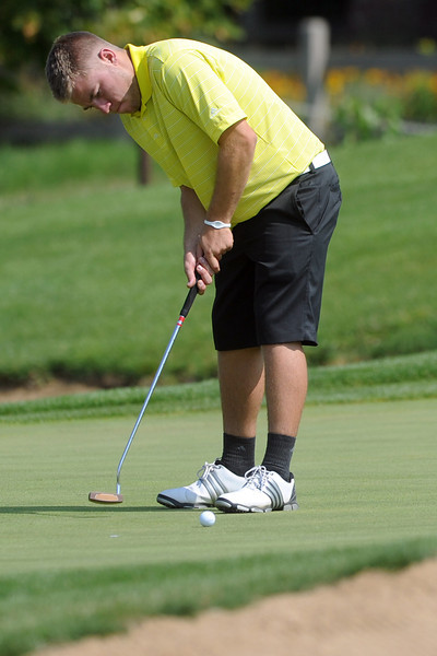 Thompson Valley High School senior Josh McLaughlin hits a putt on No. 16 during the Class 4A Regional Golf tournament at Indian Peaks Golf Course in Lafayette.