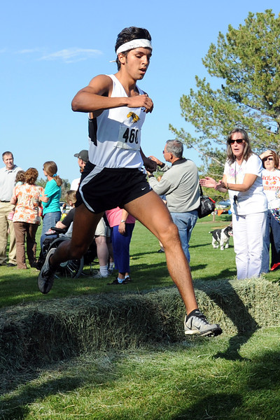 Thompson Valley High School senior Daniel Lara clears an obstacle while competing in the Sweetheart Invitational cross country meet on Friday, Sept. 28, 2012 at North Lake Park.