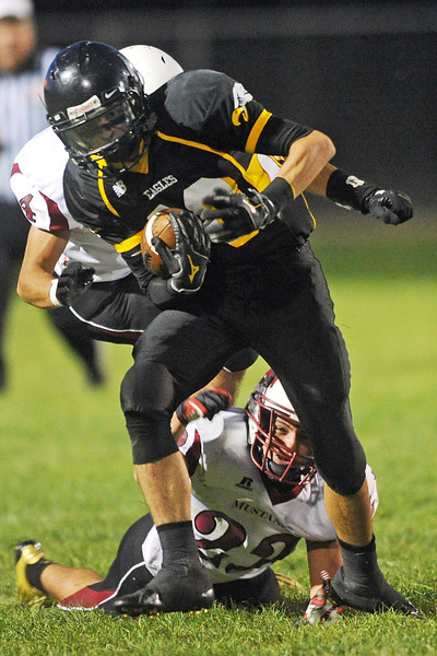 Thompson Valley High School's Drew Meintzer, front, is pursued by Fort Morgan defender Ulises Hernandez (4) in the second quarter of their game on Friday, Sept. 14, 2012 at Patterson Stadium.