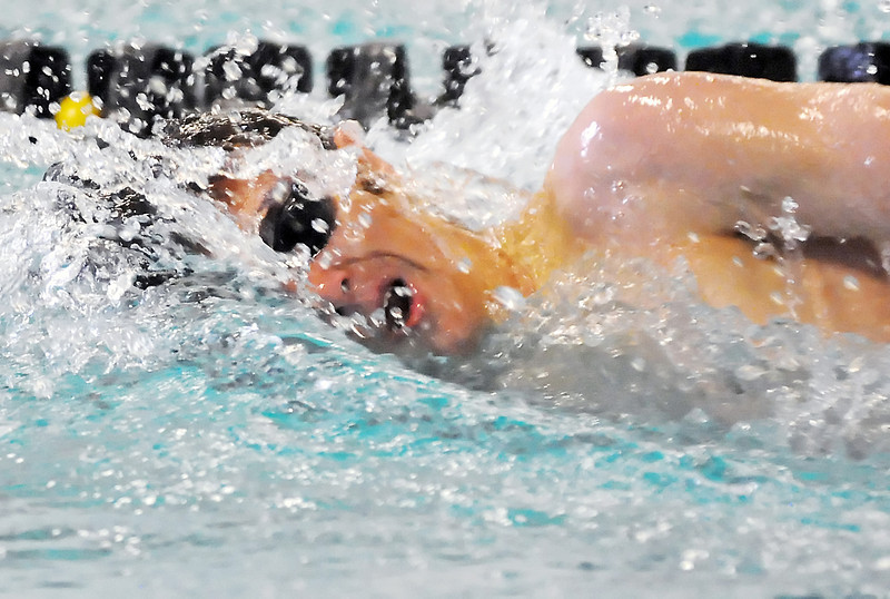 Thompson Valley High School sophomore Jack Brubacher swims a leg of the 400-yard freestyle relay during the Loveland City Meet on Tuesday, April 20, 2010 at the Moutain View Aquatic Center.