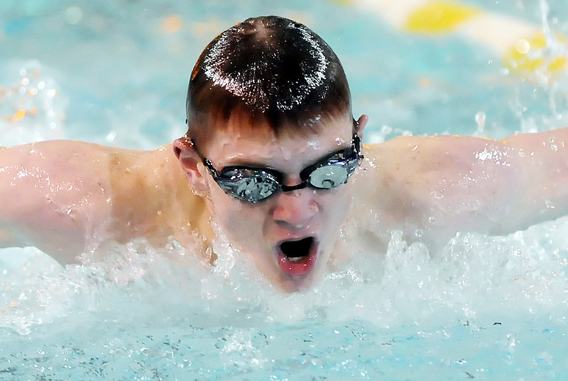 Thompson Valley High School's Austin Southard swims in the 100-yard butterfly during a dual meet Tuesday against Loveland at the Dick Hewson Aquatic Center.