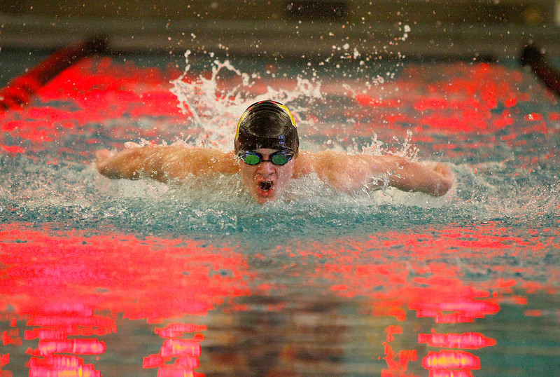 Thompson Valley High School junior, Austin Southard competes in the 100 yard butterfly Tuesday at Loveland High School. (Photo by Gabriel Christus)