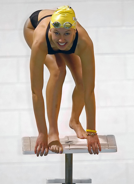 Thompson Valley High School's Maggie Varuska poses on a starting block Friday at the Dick Hewson Aquatic Center.