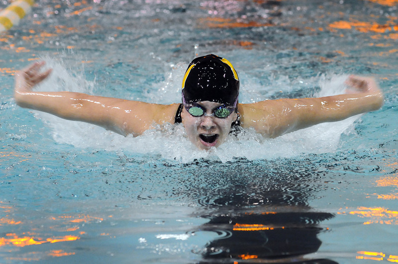 Junior Samantha Moss of Thompson Valley High School swims the 100-yard butterfly event during a meet against Fossil Ridge High School at Thompson Valley. Moss came in first in the event with a time of 1:00.89.