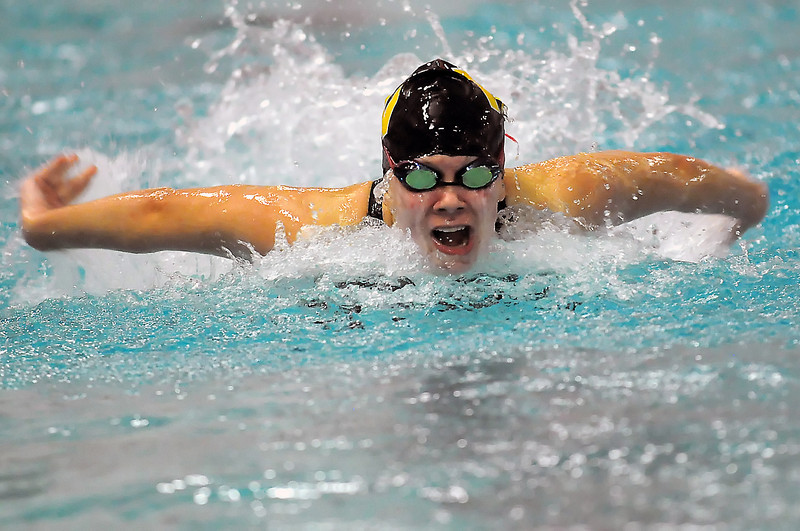 Thompson Valley High School senior Sam Moss swims in the 100-yard butterfly final during the Dick Rush Coaches Invitational swim and dive meet on Saturday, Dec. 18, 2010 at the Mountain View Aquatic Center.