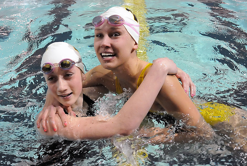 Thompson Valley High School's Maggie Varuska, right, and Rhianna Williams are all smiles as they look up at the scoreboard to see that they finished first and second respectively in the 50-yard freestyle during the Northern Conference West Swimming and Diving Championships on Saturday, Feb. 6, 2010 at the Hewson Aquatic Center.