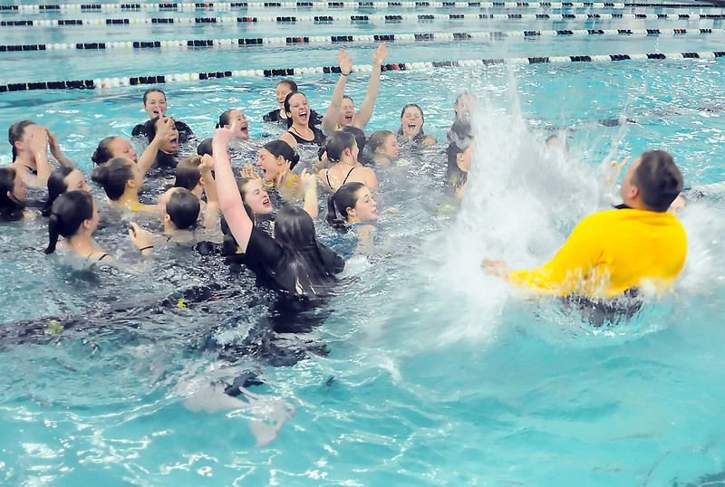 Thompson Valley High School diving coach Amon McCrary splashes down in the pool as the school's swim and dive team celebrates together after winning the team title at the Class 4A State Championships on Saturday, Feb. 13, 2010 at the Mountain View Aquatic Center.
