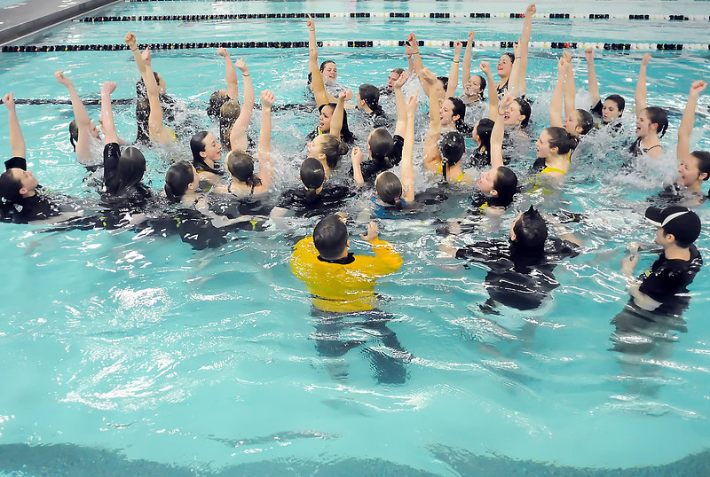Thompson Valley High School's swim and dive team members celebrate in the pool by singing the school's fight song together after winning the team title at the Class 4A State Championships on Saturday, Feb. 13, 2010 at the Mountain View Aquatic Center.
