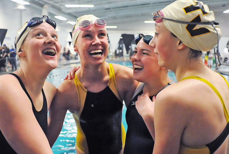 Thompson Valley High School's Sydnee King, left, Maggie Varuska, Jessi Modlich and Rhianna Williams hug each other after winning the 400-yard freestyle relay Saturday during the Class 4A State Championships on Saturday, Feb. 13, 2010. Their time of 3 minutes, 37.28 seconds is a new school record for the event.