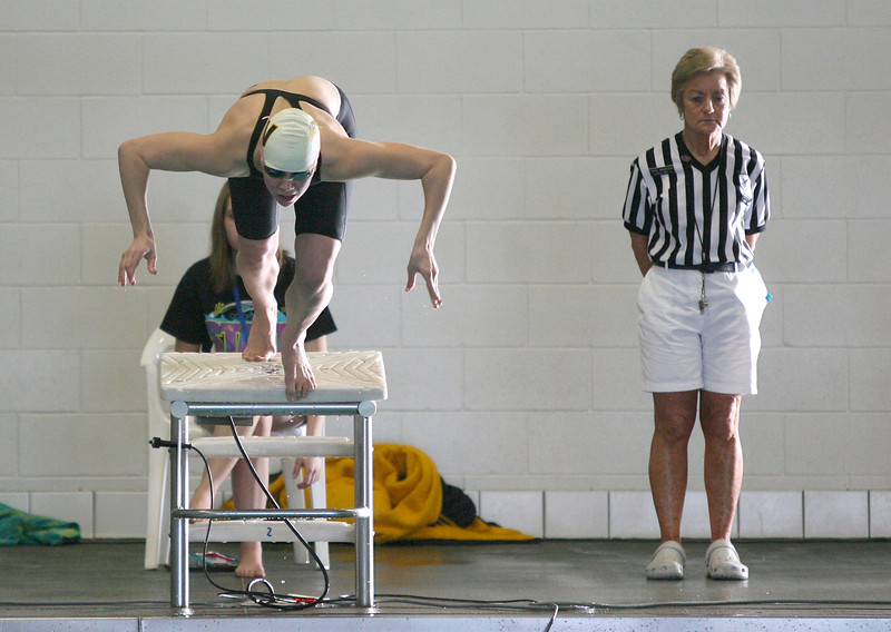 Sam Moss dives into the water in the beginning of the women's 100 yard butterfly final during the 4A State Swimming Championships Saturday at Mountain View High School.  (Photo by Gabriel Christus)