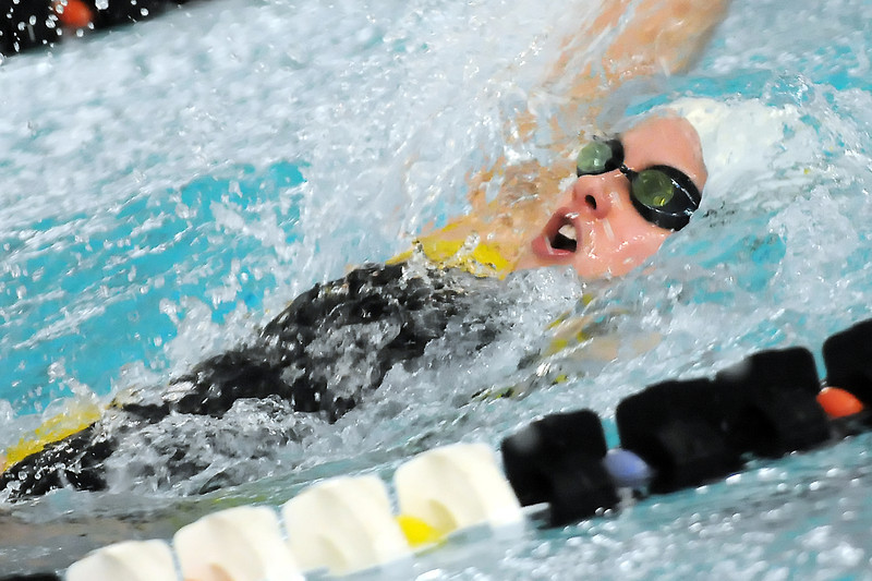 Thompson Valley High School sophomore Jessi Modlich swims in a preliminary heat of the 100-yard backstroke during the Class 4A State Swimming Championships on Friday, Feb. 11, 2011 at the Mountain View Aquatic Center in Loveland, Colo.
