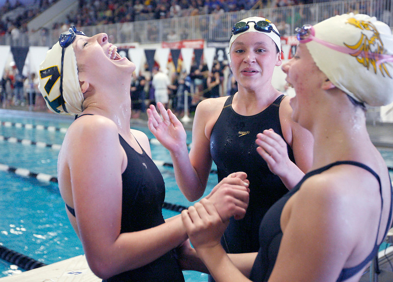 From left, Thompson Valley's Lizzie Bergquist, Kelly Sheldon and Sam Moss celebrate after winning the women's 200 yard freestyle relay finals during the 4A State Swimming Championships Saturday at Mountain View High School.  (Photo by Gabriel Christus)