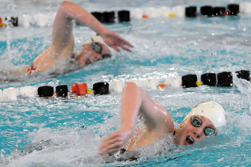 Thompson Valley High School's Nicole Hlavacek, bottom, and teammate Allie Pfauth swim in the 200-yard freestyle final during the Northern League Conference Championships on Saturday at the Mountain View Aquatic Center.