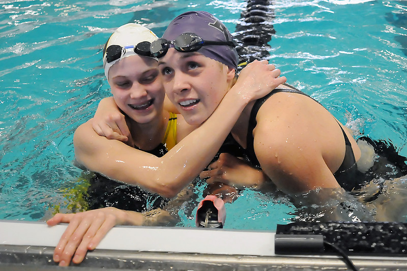Mountain View High School senior Jessica Reed-Baum, right, and Thompson Valley freshman Marina Fonseca are all smiles after finishing one and two, respectively, in the 50-yard freestyle final Saturday during the Northern League Conference Championships at the Mountain View Aquatic Center.
