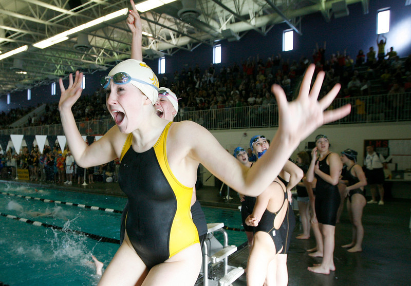 Thompson Valley's Sarah Bracken celebrates after winning the women's 200 yard medley relay finals during the 4A State Swimming Championships Saturday at Mountain View High School.  (Photo by Gabriel Christus)