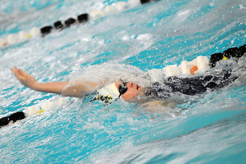 Thompson Valley High School freshman Kelly Sheldon swims in a  preliminary heat of the 100-yard backstroke during the Class 4A State Swimming Championships on Friday, Feb. 11, 2011 at the Mountain View Aquatic Center in Loveland, Colo.