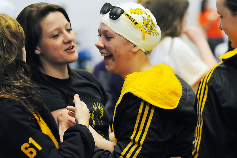 Thompson Valley High School senior Sam Moss, center, shares a laugh with teammates during the Northern League Conference Championships on Saturday at the Mountain View Aquatic Center.