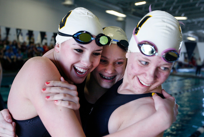 From left, Thompson Valley's Jessi Modlich, Marina Fonseca and Sam Moss celebrate after winning the women's 200 yard medley relay finals during the 4A State Swimming Championships Saturday at Mountain View High School.  (Photo by Gabriel Christus)