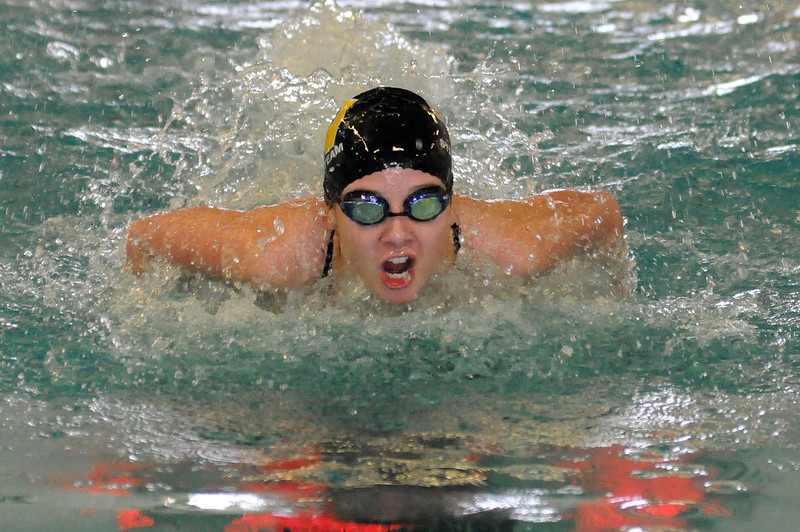 Lizzy Bergquist of Thompson Valley High School swims the butterfly part of the 200-yard individual medley event during Thursday evening's Loveland City Meet at Mountain View High School.