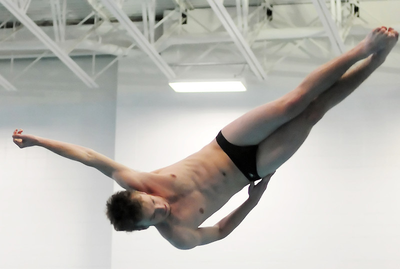 Thompson Valley High School's Travis Hartman performs a dive during the finals of the Dick Rush Invitational swim meet on Saturday at the Edora Pool Ice Center in Fort Collins. Hartman finished in second place.