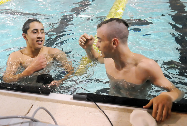 Thompson Valley High School's Adonis Reiler, left, and Jack Brubacher congratulate each other at the conclusion of the of the 50-yard freestyle finals during the Northern Conference Championships on Saturday, May 15, 2010 at the Dick Hewson Aquatic Center.