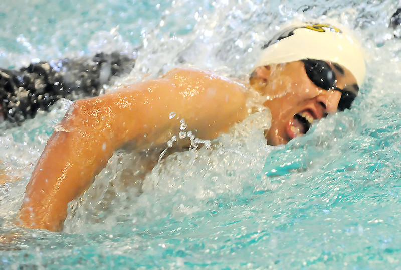 Thompson Valley High School senior Adonis Reiler swims in the consolation final of the 100-yard freestyle during the Class 4A Swimming and Diving Championships on Saturday, May 22, 2010 at the Mountain View Aquatic Center.