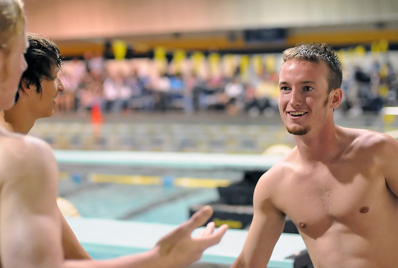 Thompson Valley High School's Travis Hartman, right, is congratulated by other divers after Hartman won the diving competition at the Northern Conference West Championships on Saturday, May 15, 2010 at the Hewson Aquatic Center.