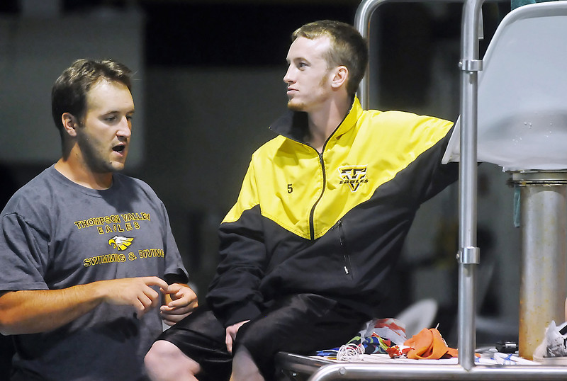 Thompson Valley High School diver Travis Hartman, right, listens to diving coach Amon McCrary during the Northern Conference West Championships on Saturday, May 15, 2010 at the Hewson Aquatic Center.